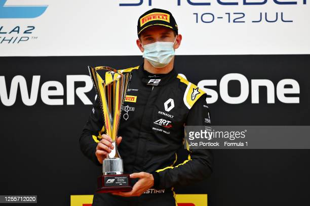 Race winner Christian Lundgaard of Denmark and ART Grand Prix celebrates on the podium during the sprint race for the Formula 2 Championship at Red...