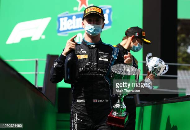 Race winner Dan Ticktum of Great Britain and DAMS celebrates on the podium during the sprint race for the Formula 2 Championship at Autodromo di...