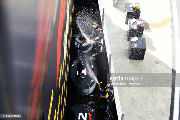 Race winner Dan Ticktum of Great Britain and DAMS , second placed Christian Lundgaard of Denmark and ART Grand Prix and third placed Louis Deletraz...