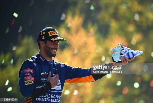 Race winner Daniel Ricciardo of Australia and McLaren F1 celebrates on the podium during the F1 Grand Prix of Italy at Autodromo di Monza on...