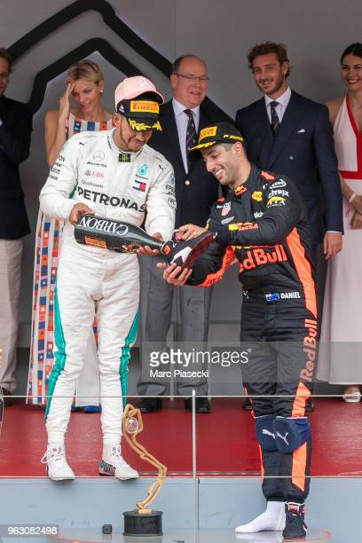 Race winner Daniel Ricciardo of Australia and Red Bull Racing and Lewis Hamilton celebrate on the podium during the Monaco Formula One Grand Prix at...