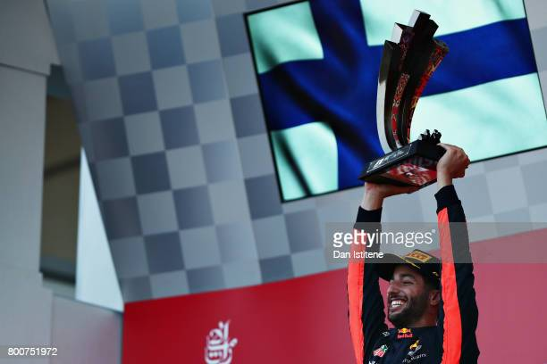 Race winner Daniel Ricciardo of Australia and Red Bull Racing celebrates his win on the podium during the Azerbaijan Formula One Grand Prix at Baku...
