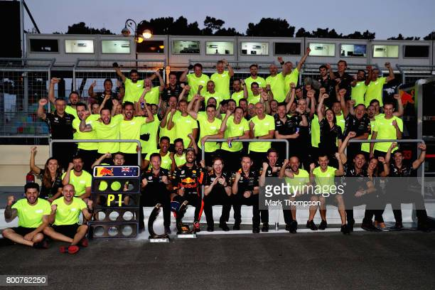 Race winner Daniel Ricciardo of Australia and Red Bull Racing celebrates his win with his team during the Azerbaijan Formula One Grand Prix at Baku...