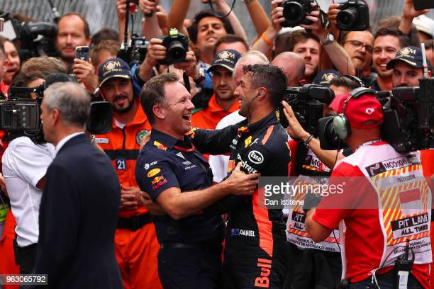 Race winner Daniel Ricciardo of Australia and Red Bull Racing celebrates in parc ferme with Red Bull Racing Team Principal Christian Horner during...