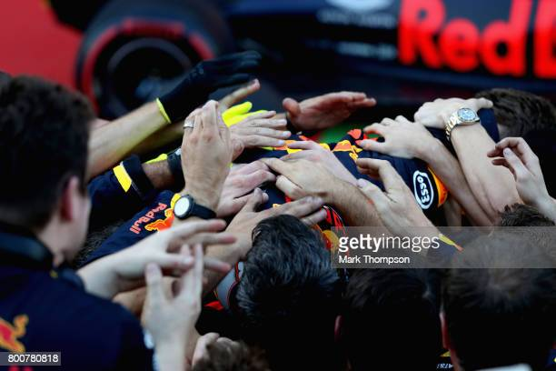 Race winner Daniel Ricciardo of Australia and Red Bull Racing is mobbed by his team in parc ferme during the Azerbaijan Formula One Grand Prix at...