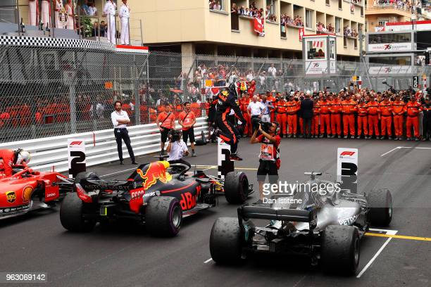 Race winner Daniel Ricciardo of Australia and Red Bull Racing leaps from his car in parc ferme during the Monaco Formula One Grand Prix at Circuit de...