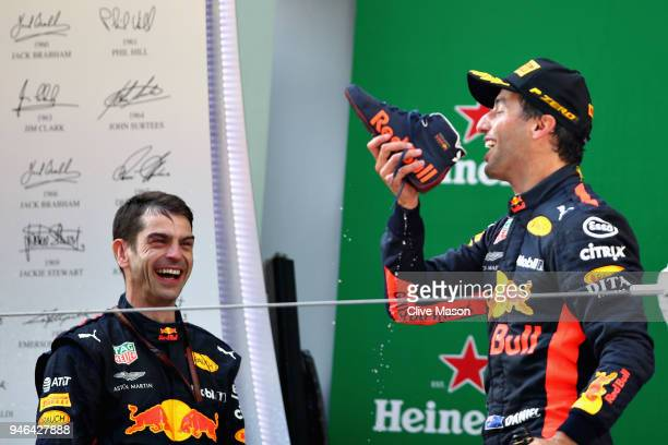 Race winner Daniel Ricciardo of Australia and Red Bull Racing celebrates on the podium with a shoey during the Formula One Grand Prix of China at...