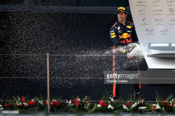 Race winner Daniel Ricciardo of Australia and Red Bull Racing celebrates on the podium during the Formula One Grand Prix of China at Shanghai...