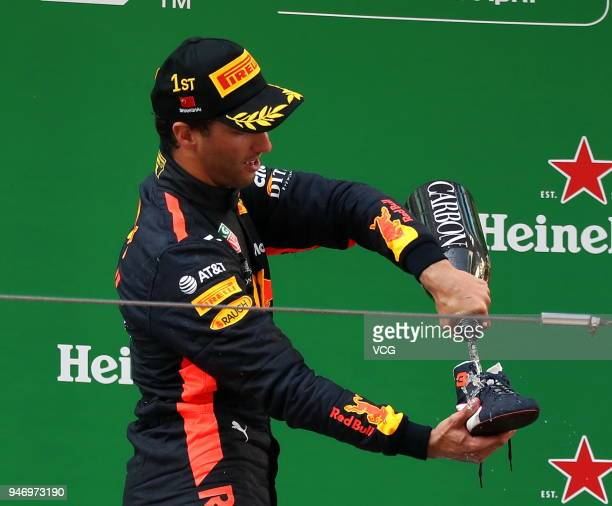 Race winner Daniel Ricciardo of Australia and Red Bull Racing celebrates on the podium during the Formula One Grand Prix of China at Shanghai...