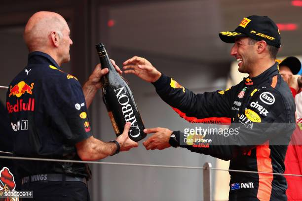 Race winner Daniel Ricciardo of Australia and Red Bull Racing celebrates on the podium with Adrian Newey the Chief Technical Officer of Red Bull...