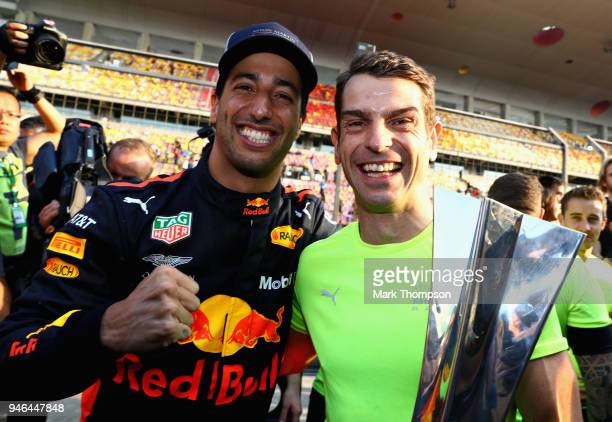 Race winner Daniel Ricciardo of Australia and Red Bull Racing celebrates with No1 Mechanic Chris Gent after the Formula One Grand Prix of China at...