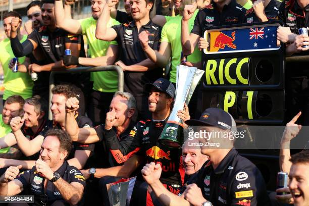 Race winner Daniel Ricciardo of Australia and Red Bull Racing celebrates with his team after the Formula One Grand Prix of China at Shanghai...