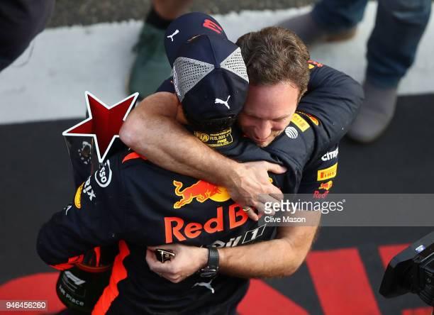 Race winner Daniel Ricciardo of Australia and Red Bull Racing celebrates with Red Bull Racing Team Principal Christian Horner after the Formula One...