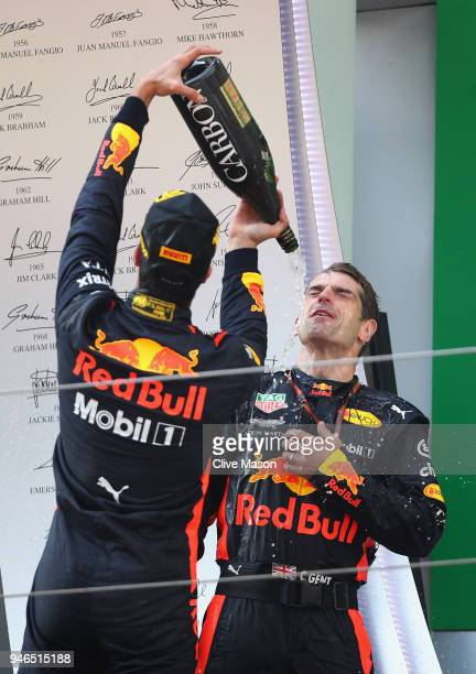 Race winner Daniel Ricciardo of Australia and Red Bull Racing celebrates with his No1 mechanic Chris Gent on the podium during the Formula One Grand...