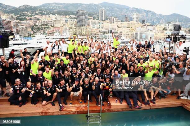 Race winner Daniel Ricciardo of Australia and Red Bull Racing celebrates with his team on the Red Bull Energy Station during the Monaco Formula One...
