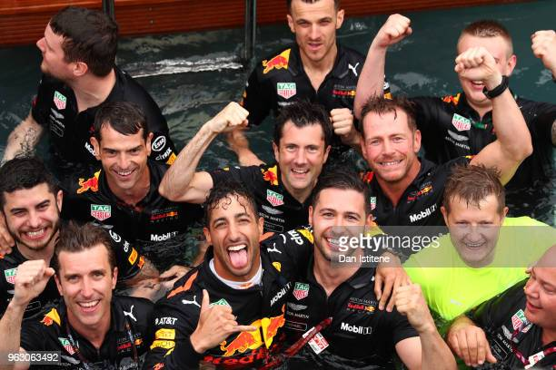 Race winner Daniel Ricciardo of Australia and Red Bull Racing celebrates with his team in the swimming pool of the Red Bull Energy Station after the...