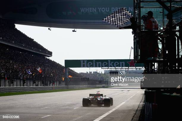 Race winner Daniel Ricciardo of Australia driving the Aston Martin Red Bull Racing RB14 TAG Heuer takes the chequered flag during the Formula One...