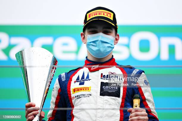 Race winner David Beckmann of Germany and Trident celebrates on the podium during race two of the Formula 3 Championship at Hungaroring on July 19,...