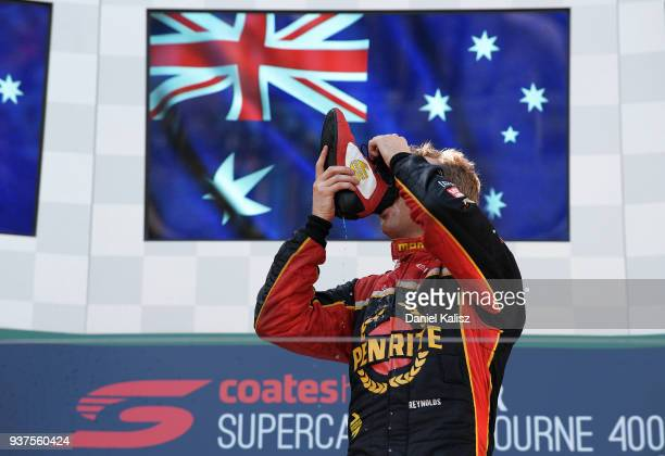 Race winner David Reynolds driver of the Erebus Penrite Racing Holden Commodore ZB celebrates on the podium during race 4 for the Supercars...