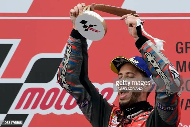 Race winner Ducati Team's Italian rider Andrea Dovizioso celebrates on the podium after the MotoGP race of the Valencia Grand Prix at the Ricardo...