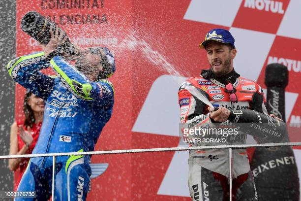 Race winner Ducati Team's Italian rider Andrea Dovizioso celebrates on the podium with second placed Team SUZUKI ECSTAR's Spanish rider Alex Rins...