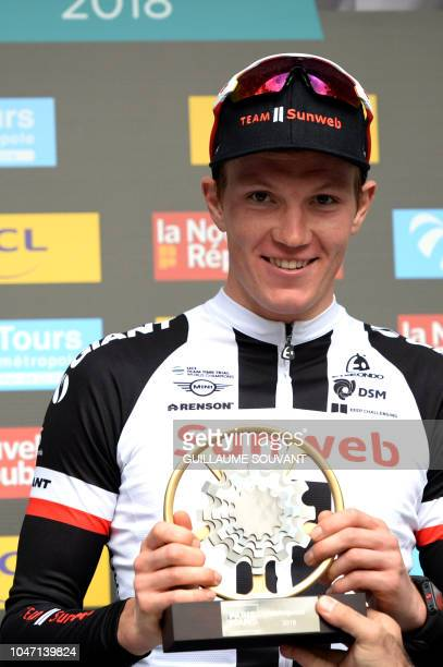 Race winner, Dutch cyclist Soren Kragh Andersen of team Team Sunweb celebrates on the podium of the single-day Paris-Tours cycling race over 214,5...