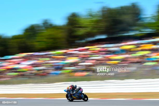 TOPSHOT Race winner EG 00 Marc VDS Spanish rider Alex Marquez competes in the Moto2 race of the Catalunya Grand Prix at the Montmelo racetrack near...