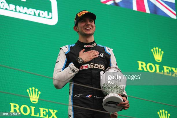 Race winner Esteban Ocon of France and Alpine F1 Team celebrates on the podium during the F1 Grand Prix of Hungary at Hungaroring on August 01, 2021...