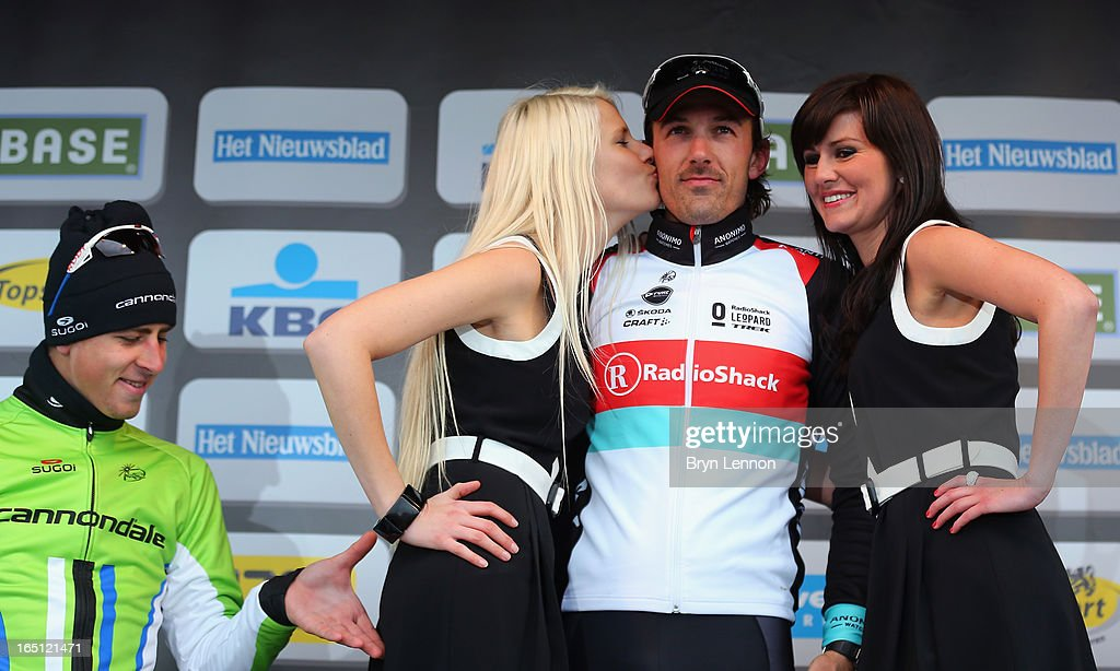 Race winner Fabian Cancellara of Switzerland and RadioShack Leopard standards on top of the podium as Peter Sagan of Slovakia and Cannondale looks on during the 97th Tour of Flanders from Brugge to Oudenaarde on March 31, 2013 in Oudenaarde, Belgium.