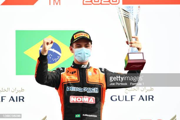 Race winner Felipe Drugovich of Brazil and MP Motorsport celebrates on the podium during the Round 11:Sakhir Feature Race of the Formula 2...