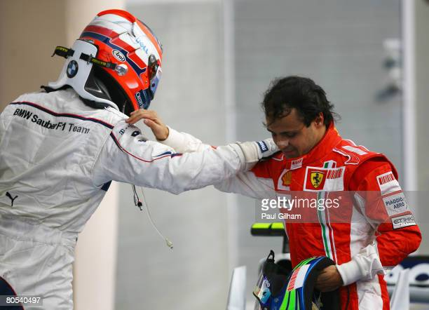 Race winner Felipe Massa of Brazil and Ferrari congratulates third placed Robert Kubica of Poland and BMW Sauber in parc ferme the Bahrain Formula...