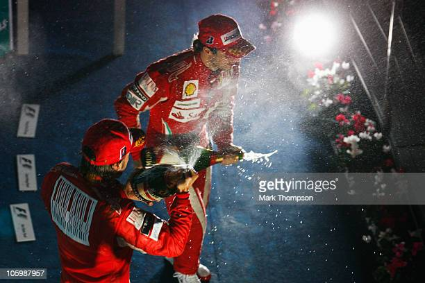 Race winner Fernando Alonso of Spain and Ferrari and third placed team mate Felipe Massa of Brazil and Ferrari celebrate on the podium following the...