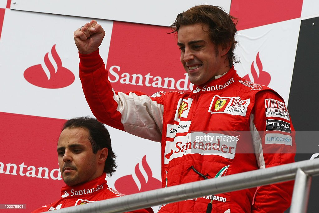 Race winner Fernando Alonso (R) of Spain and Ferrari celebrates on the podium alongside second placed team mate Felipe Massa (L) of Brazil and Ferrari after the German Grand Prix at Hockenheimring on July 25, 2010 in Hockenheim, Germany.