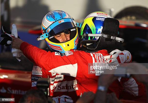 Race winner Fernando Alonso of Spain and Ferrari is congratulated by second placed Felipe Massa of Brazil and Ferrari in parc ferme after the Bahrain...