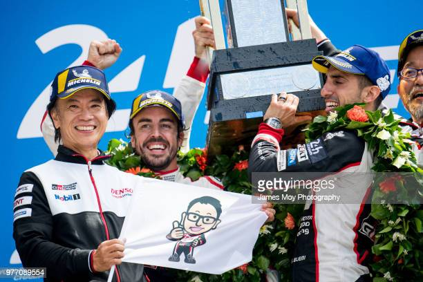 Race winner Fernando Alonso of Spain and Toyota Gazoo Racing celebrates on the podium with Sebastien Buemi of Switzerland and Toyota Gazoo Racing at...