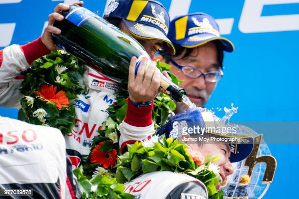 Race winner Fernando Alonso of Spain and Toyota Gazoo Racing celebrates on the podium with Kamui Kobayashi of Japan and Toyota Gazoo Racing at the Le...
