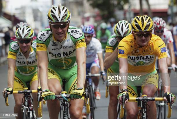 Race winner Floyd Landis of the USA and Phonak rides at the front of the peloton with his team mate, and son of 5 times Tour de France winner Eddy...