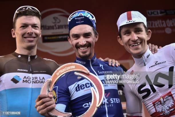 Race winner France's Julian Alaphilippe runnerup Belgium's Oliver Naesen and thirdplaced Poland's Michal Kwiatkowski celebrate on the podium after...