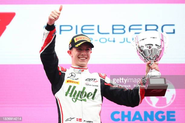 Race winner Frederik Vesti of Denmark and ART Grand Prix celebrates on the podium during race 3 of Round 3:Spielberg of the Formula 3 Championship at...