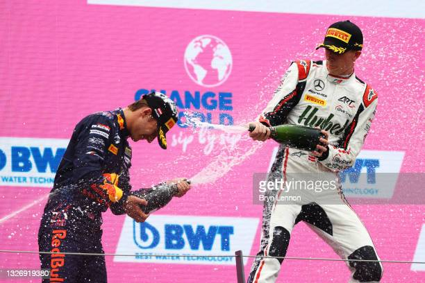 Race winner Frederik Vesti of Denmark and ART Grand Prix celebrates with second placed Dennis Hauger of Norway and Prema Racing on the podium during...
