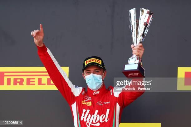 Race winner Frederik Vesti of Denmark and Prema Racing celebrates on the podium during the Formula 3 Championship First Race at Mugello Circuit on...