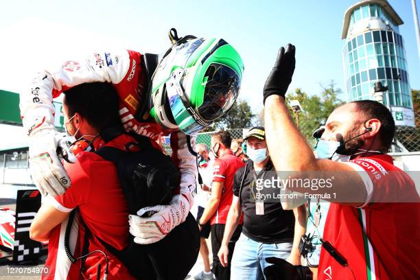 Race winner Frederik Vesti of Denmark and Prema Racing celebrates with his team during race one of the Formula 3 Championship at Autodromo di Monza...