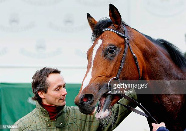 Race winner Grand Show with trainer Walter Swinburn after Division Two of The Faucets For Grohe Maiden Stakes Race run at Lingfield Park Racecourse...