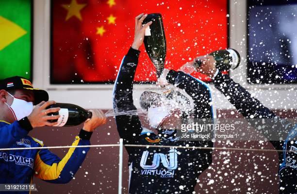 Race winner Guanyu Zhou of China and UNI-Virtuosi Racing and second placed Felipe Drugovich of Brazil and UNI-Virtuosi Racing celebrate on the podium...