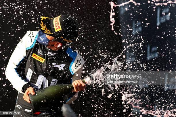 Race winner Guanyu Zhou of China and UNI-Virtuosi Racing celebrates on the podium during the Feature Race of Round 1:Sakhir of the Formula 2...