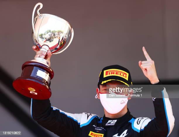 Race winner Guanyu Zhou of China and UNI-Virtuosi Racing celebrates on the podium during Sprint Race 1 of Round 2:Monte Carlo of the Formula 2...