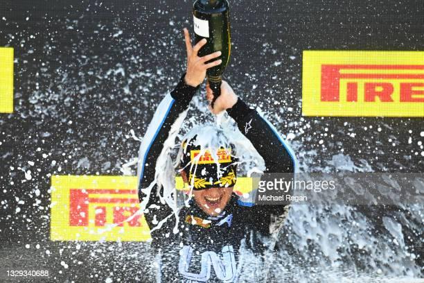 Race winner Guanyu Zhou of China and UNI-Virtuosi Racing celebrates on the podium during the Round 4:Silverstone feature race of the Formula 2...