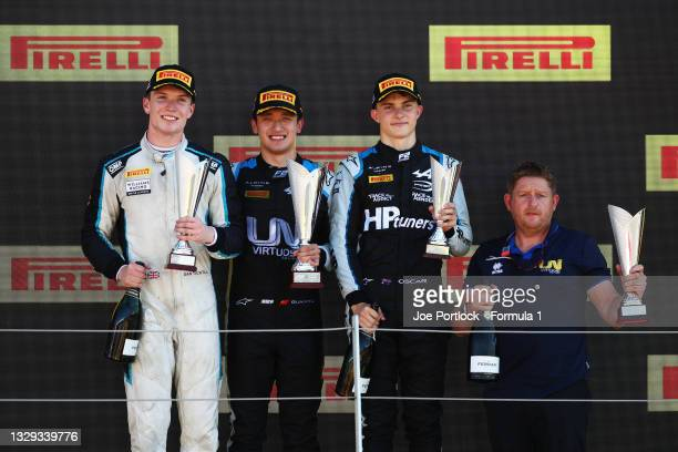 Race winner Guanyu Zhou of China and UNI-Virtuosi Racing, second placed Dan Ticktum of Great Britain and Carlin and third placed Oscar Piastri of...