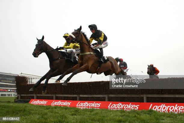 Race winner Harry Cobden jumps the water jump on Elegant Escape along with Aiden Coleman on Fountains Windfall during The Ladbrokes John Francome...