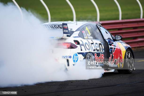 Race winner Jamie Whincup driver of the Red Bull Holden Racing Team Holden Commodore ZB celebrates during race 24 for the Supercars Sandown 500 at...